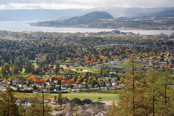 Image: City of Kelowna with fall colors, lake & mountain.