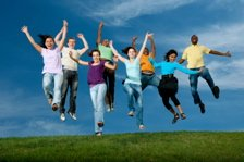 Image: Group of youth jumping in the air together.